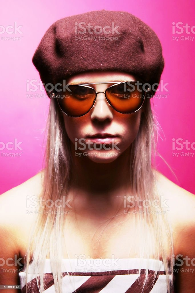 girl with hat on a pink background stock photo
