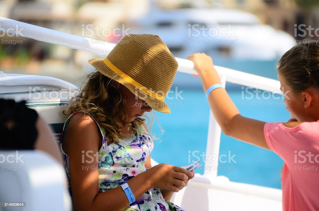 girl with hat on vacation stock photo