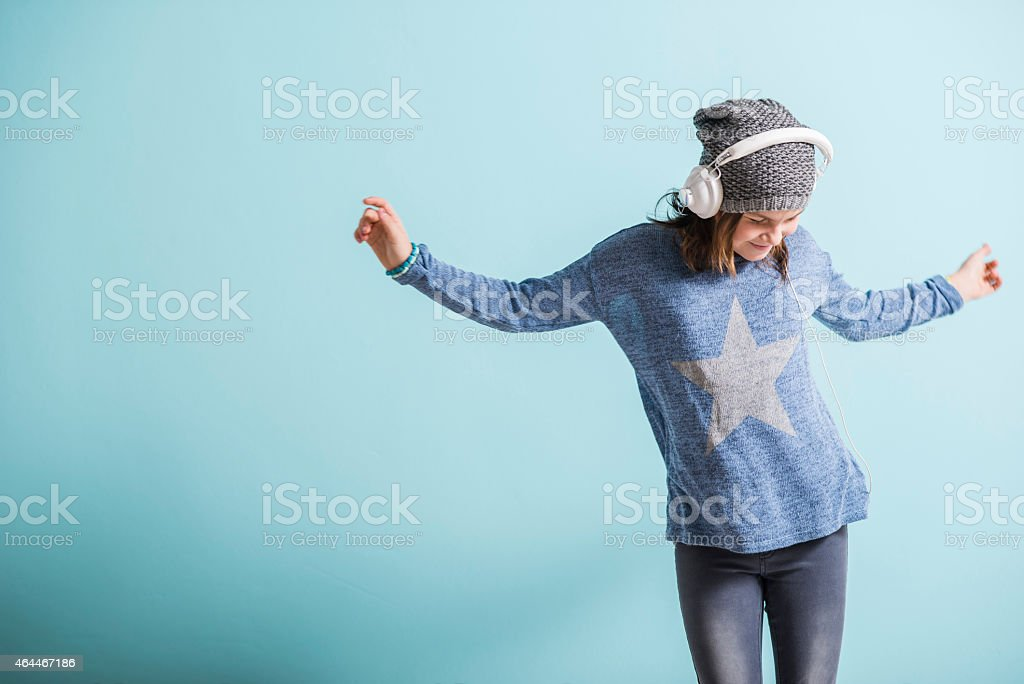 Girl With Head Phones Dancing And Listening To Music Stock ...