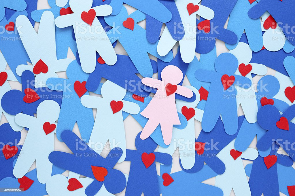 Girl with heart around boys royalty-free stock photo