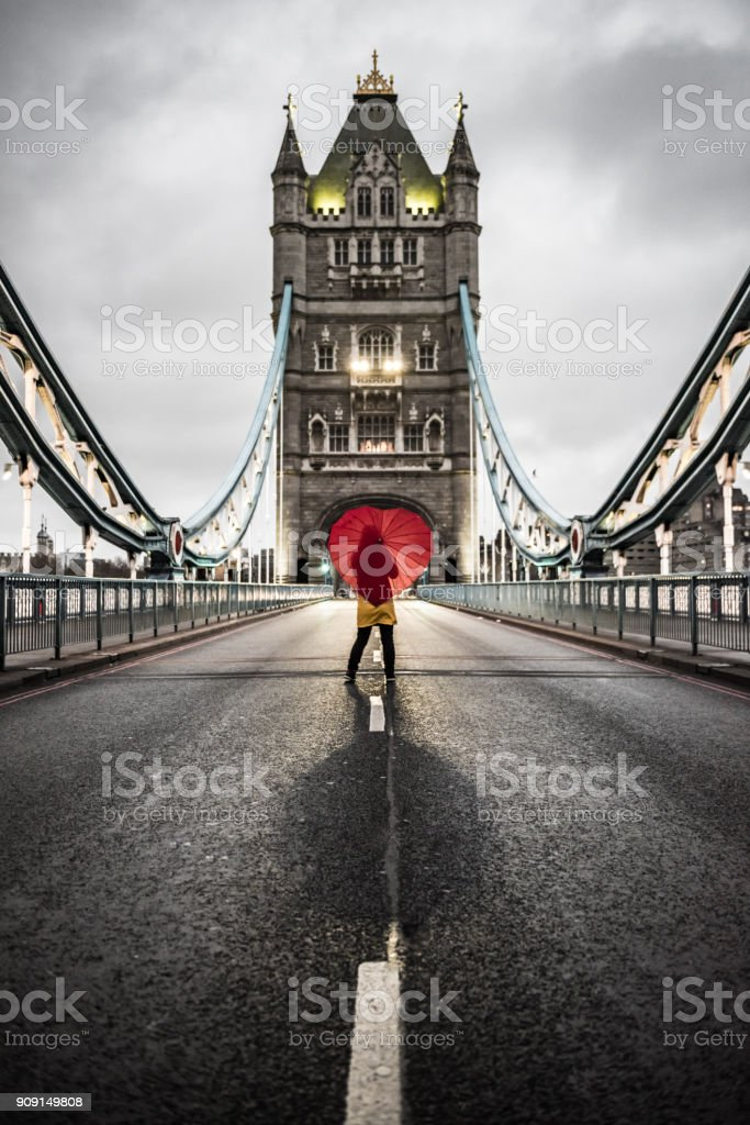 Girl with heart shaped umbrella on Tower Bridge 2 stock photo