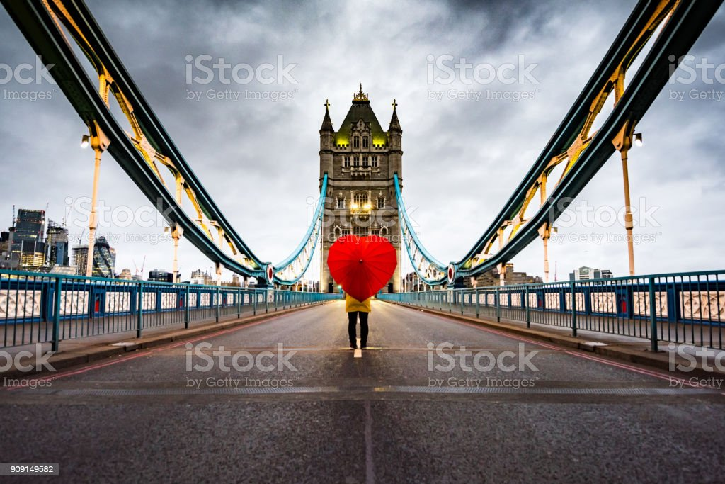 Girl with heart shaped umbrella on Tower Bridge, London stock photo