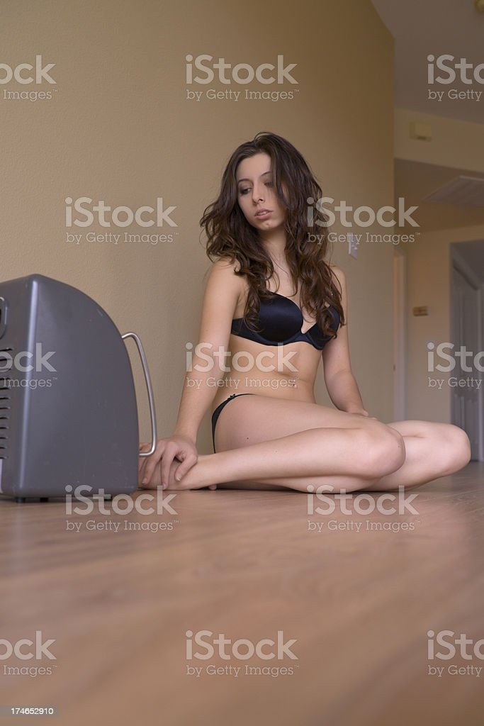 Girl with Heater in Empty House stock photo