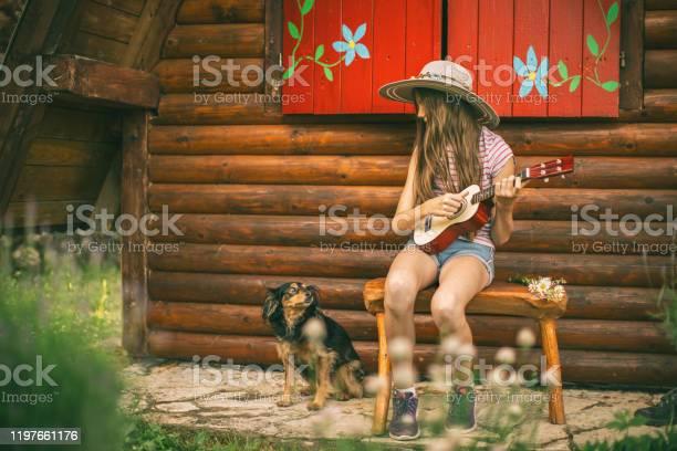 Girl with her dog in front yard picture id1197661176?b=1&k=6&m=1197661176&s=612x612&h=xwhd3ddqcuzpis3jfvxsonfq1kdug kvtokl0mzitqk=