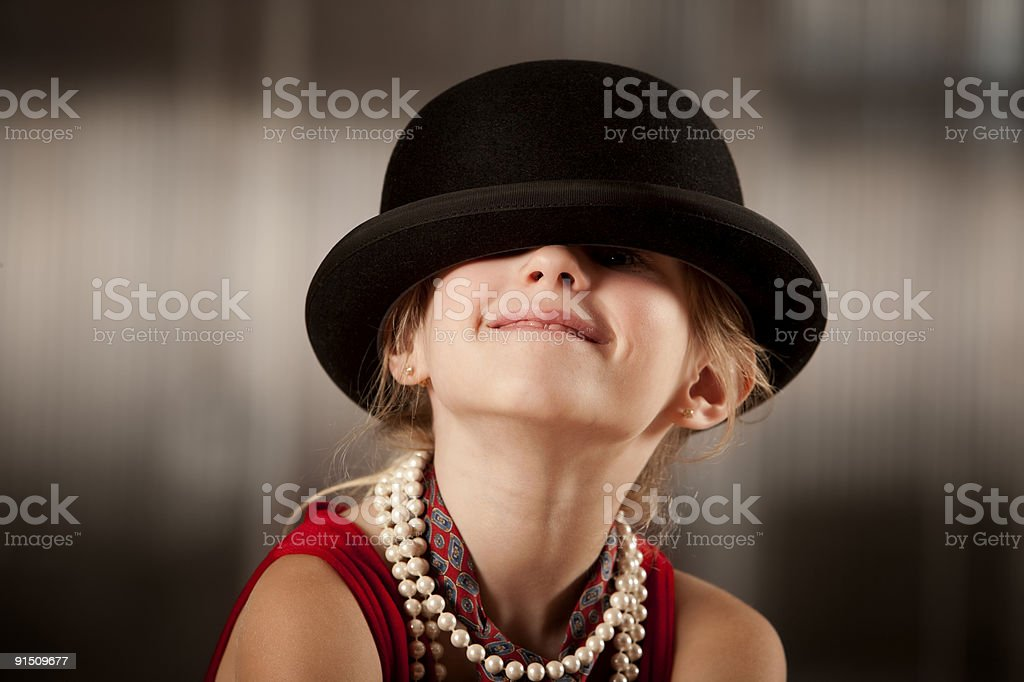Girl with her face in hat stock photo