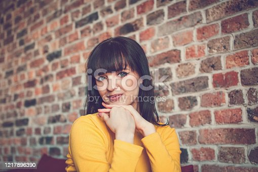 897056188 istock photo Girl with her hands under her chin 1217896390