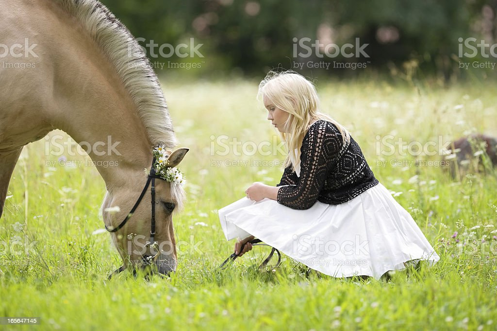 Girl with her horse royalty-free stock photo