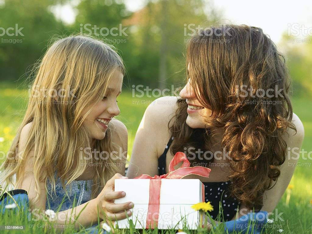Girl with her mommy royalty-free stock photo