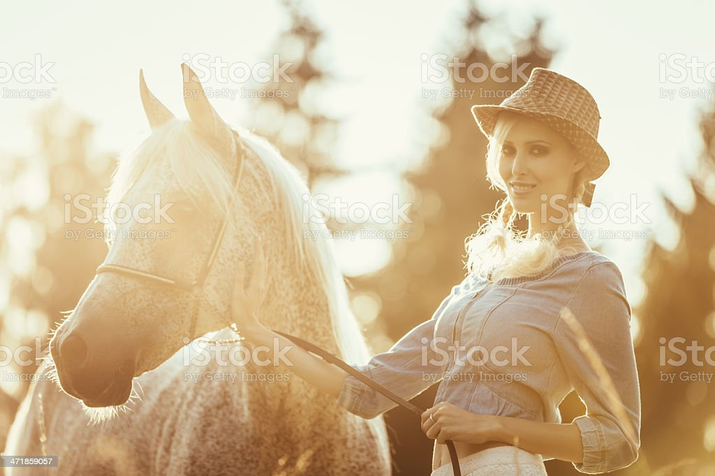 Girl with Horse Enjoying Summer Sunset Outdoors royalty-free stock photo