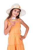 Smiling girl in hat eating the cone of ice cream, isolated on white