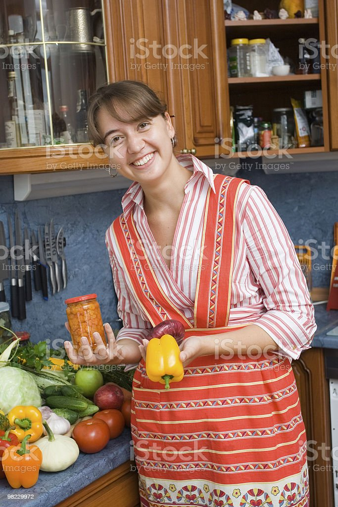 Girl with jar and pepper royalty-free stock photo