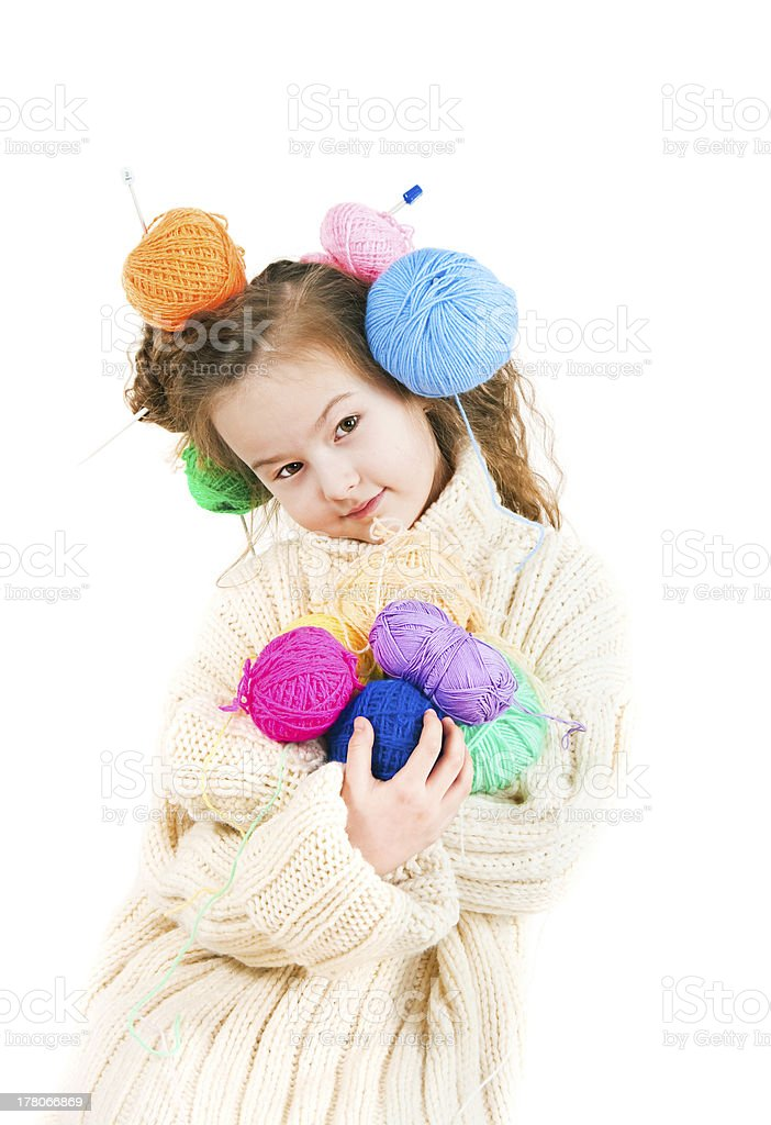 Girl with knitting spokes and balls of threads in hair stock photo
