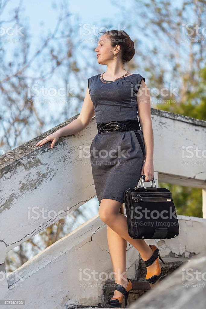 Girl with laptop down stairs stock photo