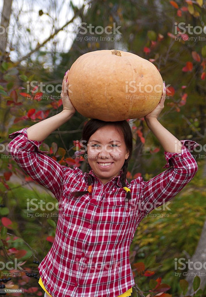 Girl with large pumpkin stock photo
