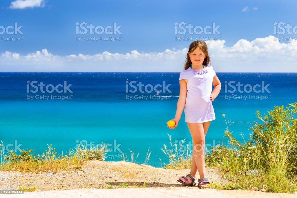 Girl with lemon posing against Cretan sea. Bali stock photo