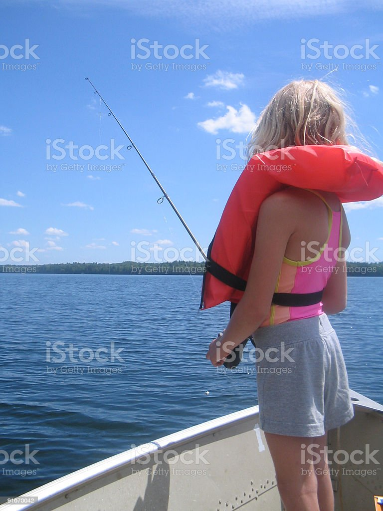 Girl With Life Jacket Fishing royalty-free stock photo