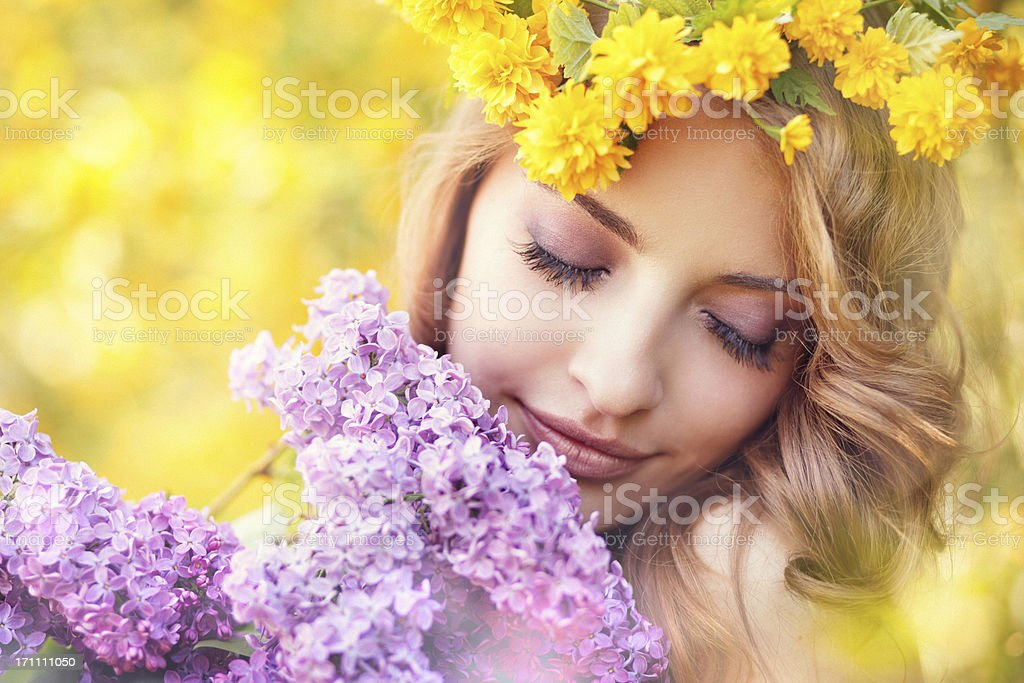 girl with lilac boquet and yellow flower wreath royalty-free stock photo