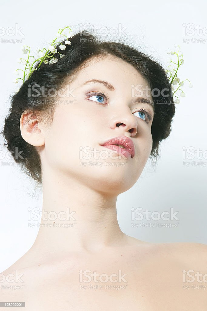 girl with lilies of the valley in hair royalty-free stock photo