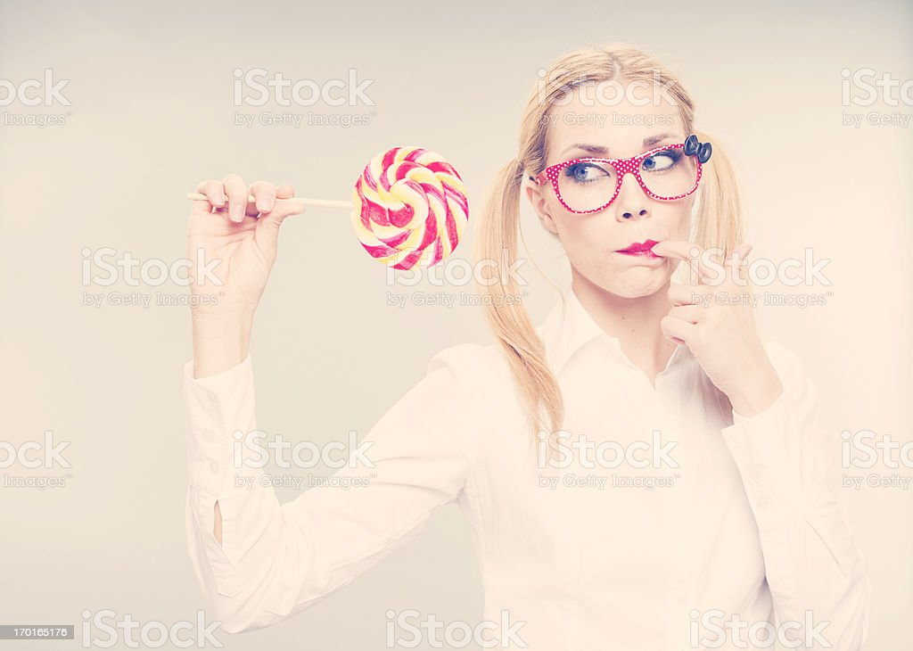 Girl with lollipop royalty-free stock photo