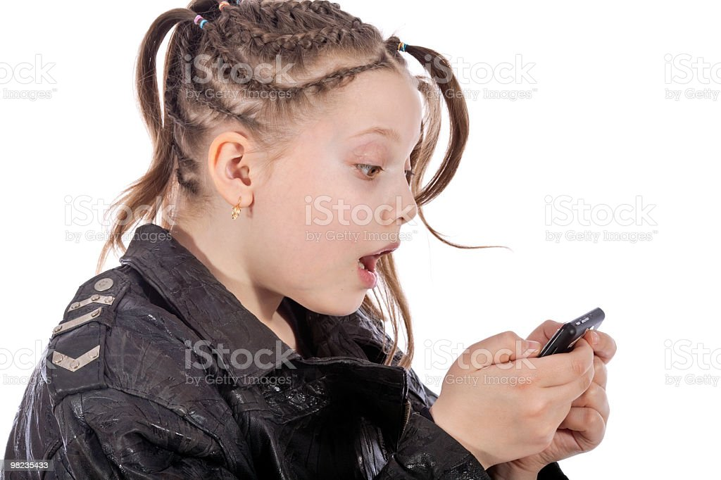 Girl with lot of bunches looks on ipod royalty-free stock photo
