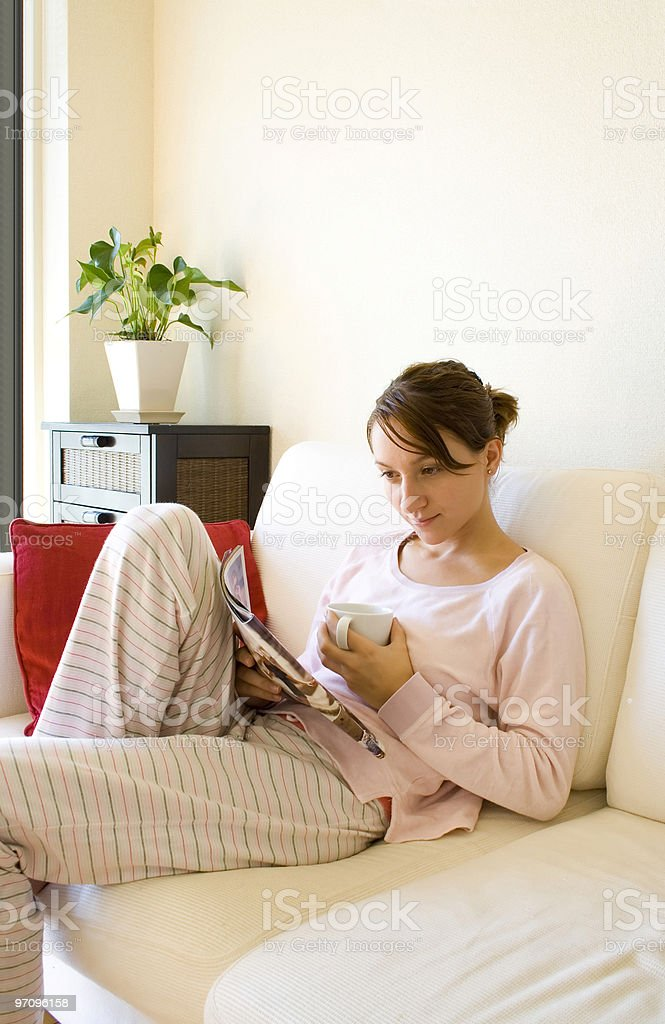 Girl with magazine in the morning royalty-free stock photo