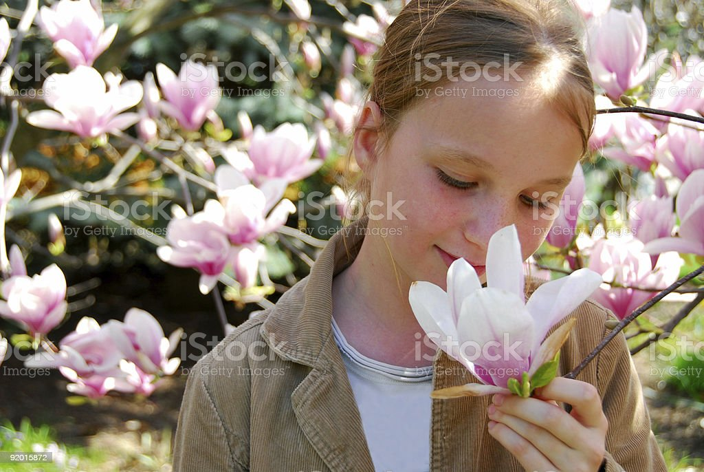 Girl with magnolia royalty-free stock photo