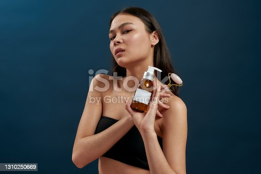 istock Girl with makeup to improve her beauty 1310250669