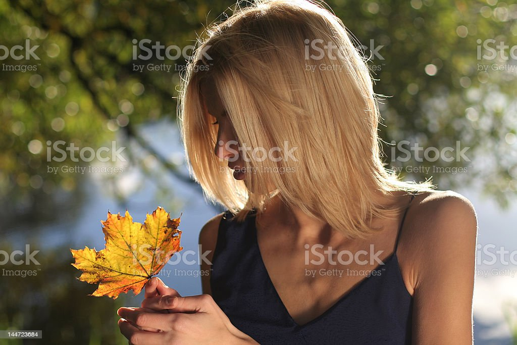 Girl with maple leaf royalty-free stock photo