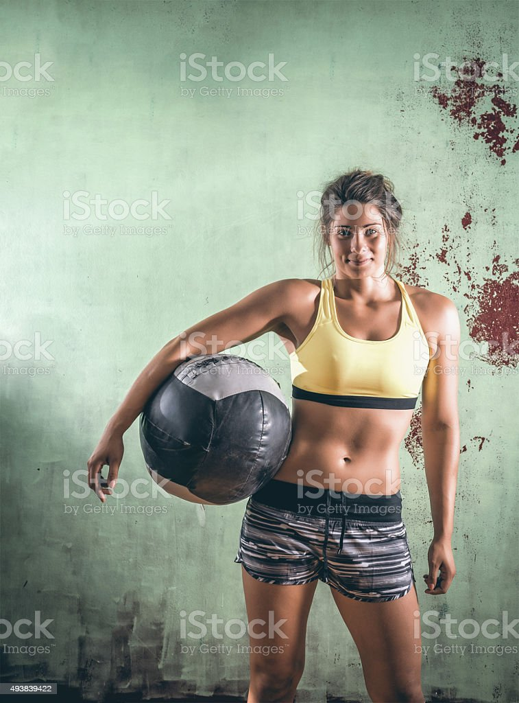 Girl with medicine ball stock photo
