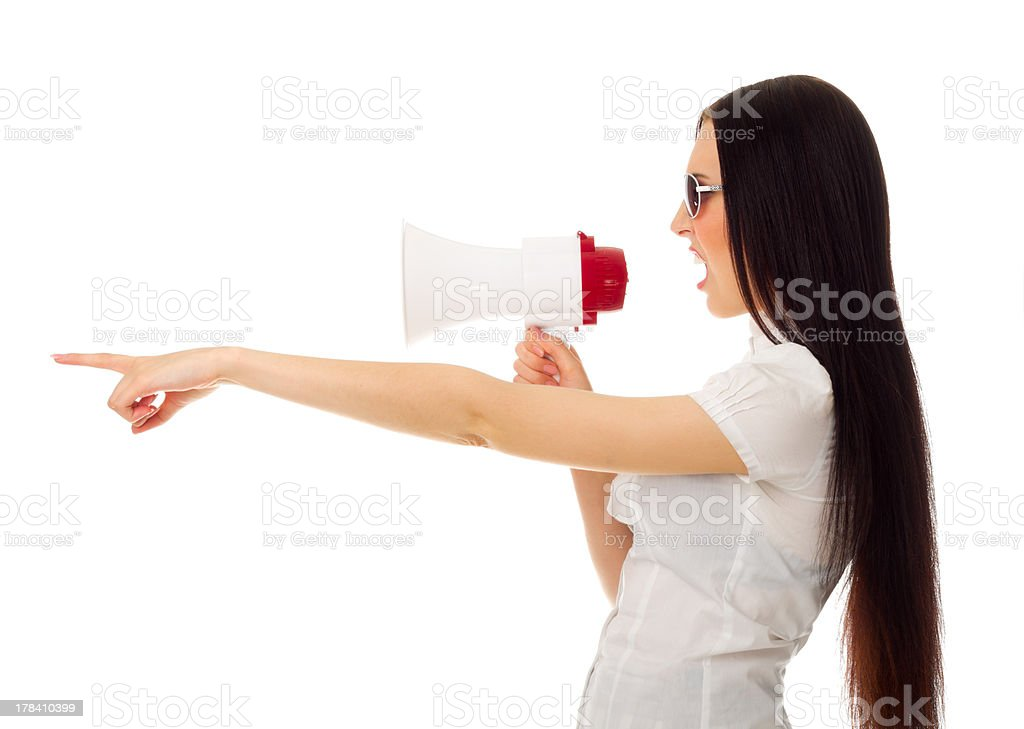 Girl with megaphone shows pointing gesture royalty-free stock photo