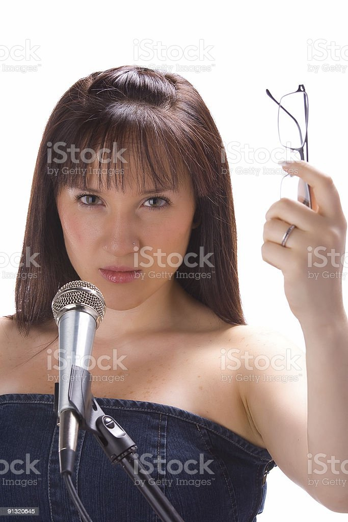 Girl with mic and glasses stock photo