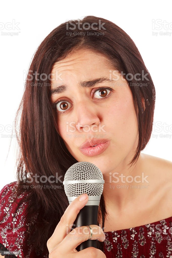 Girl with mic in white foto royalty-free
