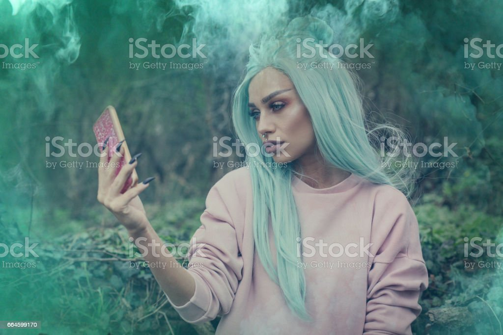 Girl with mint wig outdoor. stock photo