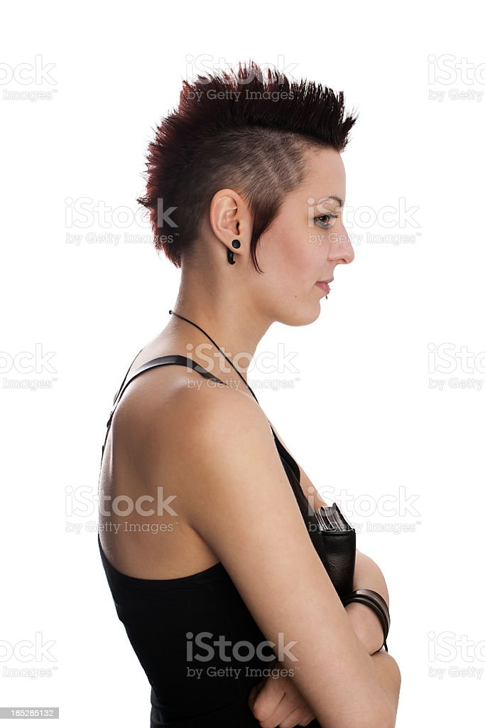 Girl with mohawk holding a bible stock photo