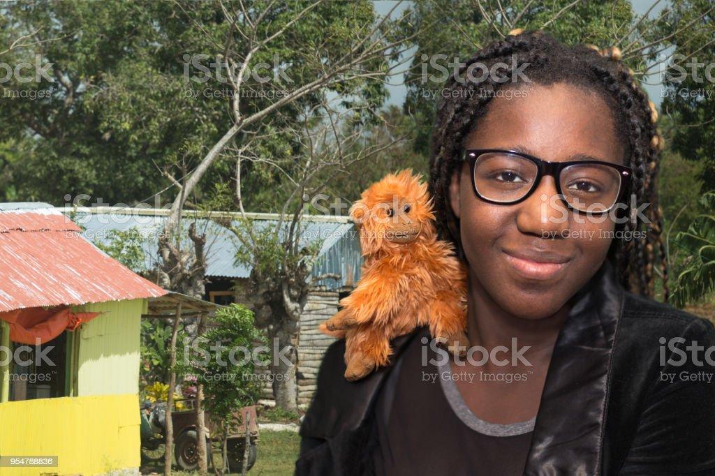 Girl with monkey stuffed toy on shoulder stock photo