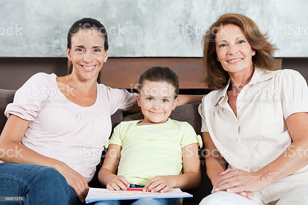 Girl with mother and grandmother royalty-free stock photo
