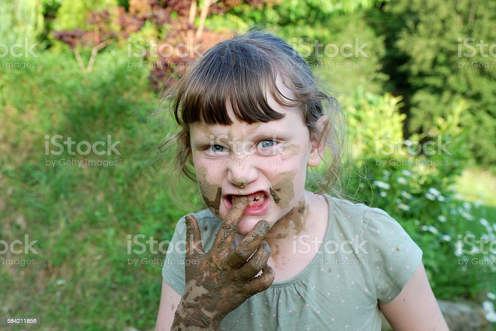 girl with muddy hands stock photo
