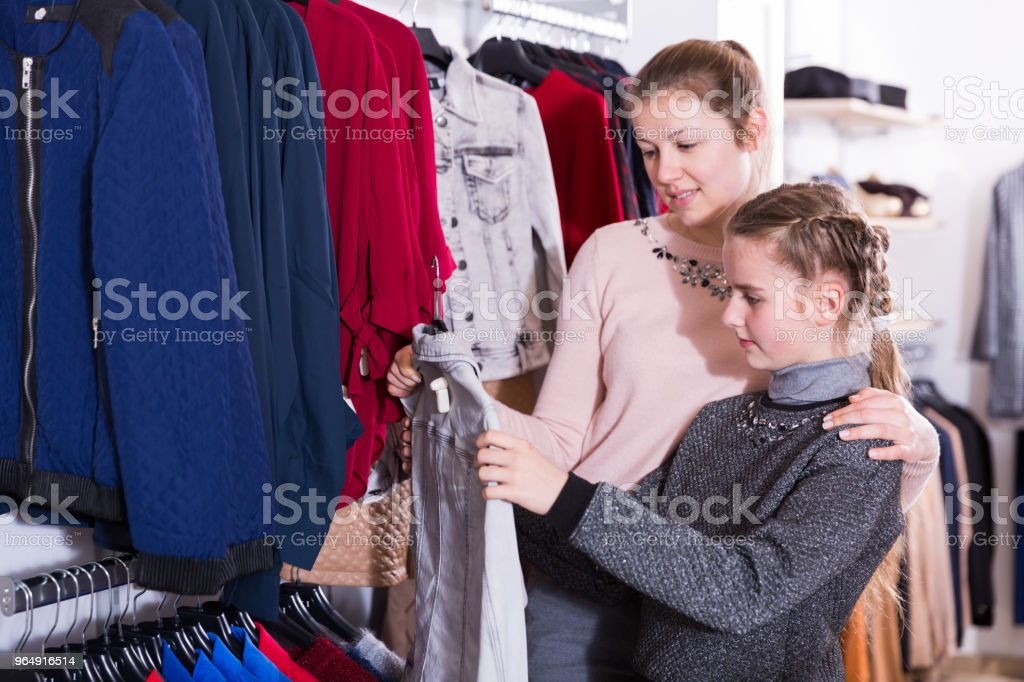 Girl with mum in clothing shop royalty-free stock photo