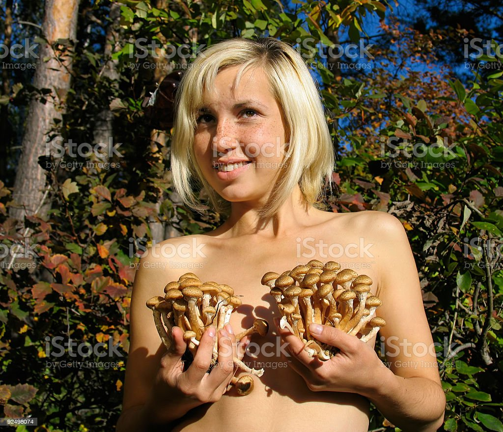Girl with mushrooms royalty-free stock photo