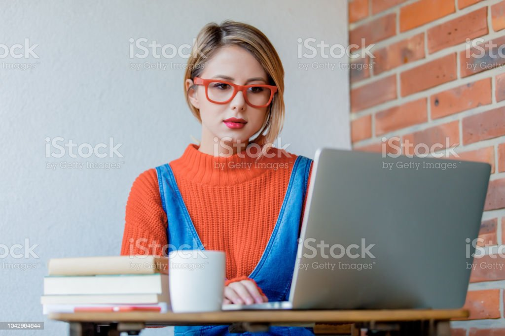 girl with notebook computer sitting and working stock photo