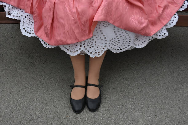 girl with old petticoat hand embroidered cotton - petticoat stock pictures, royalty-free photos & images