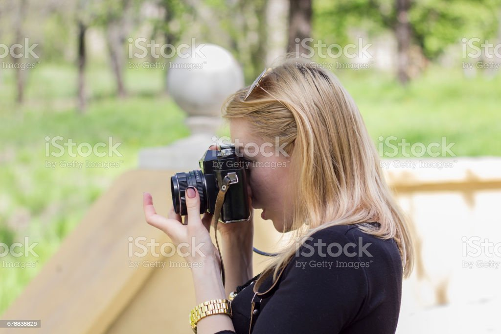 Girl with old photo camera royalty-free stock photo