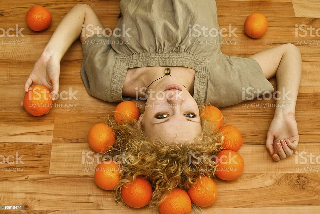 Girl with oranges royalty-free stock photo