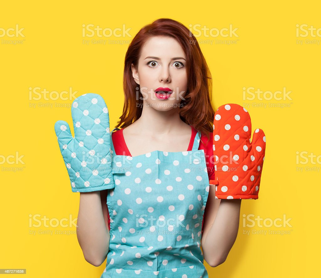 girl with oven gloves and apron stock photo