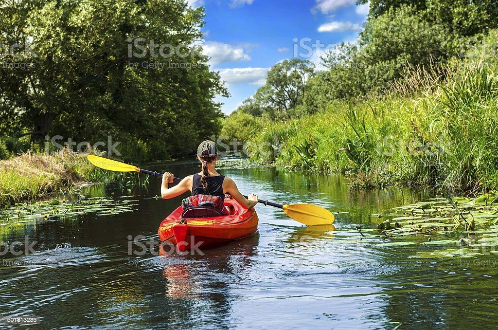 Girl with paddle and kayak  6 stock photo