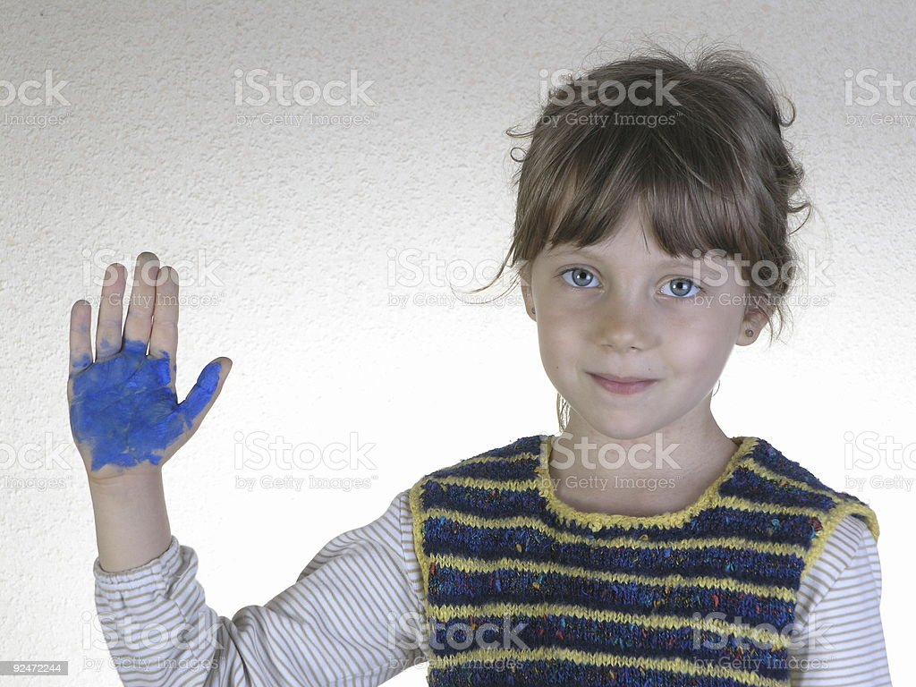 Girl with paint on hand royalty-free stock photo