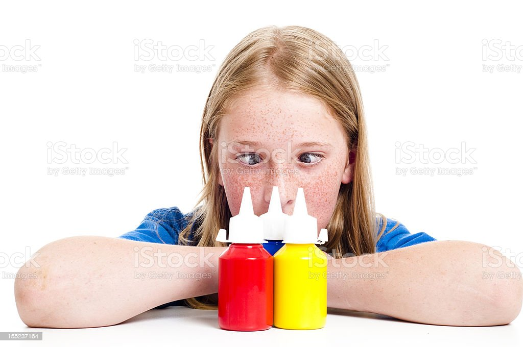 Girl with paint pots royalty-free stock photo