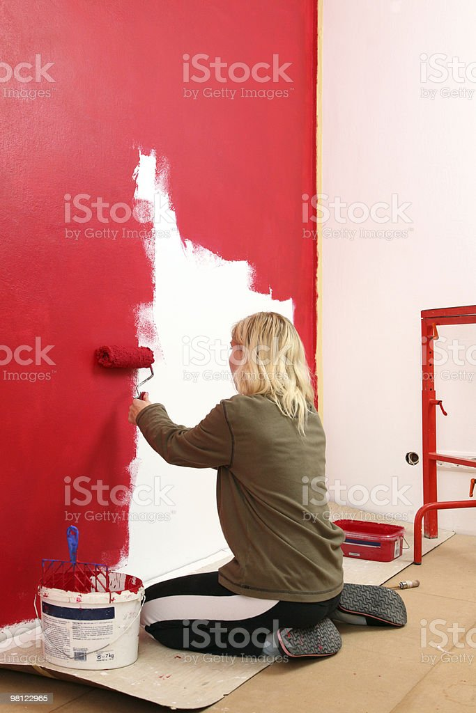 Girl with paint roller. royalty-free stock photo