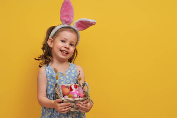Girl with painted eggs stock photo