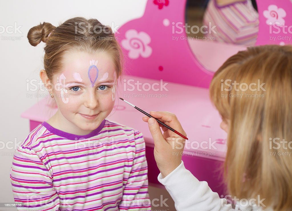 Girl with painted face royalty-free stock photo
